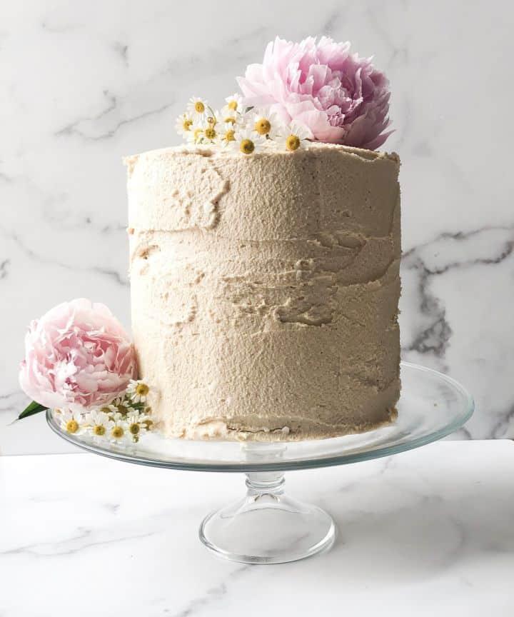 paleo vanilla cake on a clear cake holder