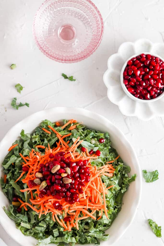 The Best Kale Salad overhead shot with a pink glass of water