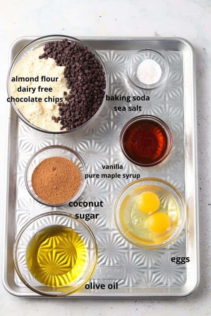 sheet pan with all of the ingredients for paleo olive oil cookies with chocolate chips