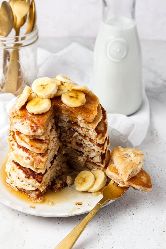 3 ingredient protein pancakes on a plate with a fork and milk