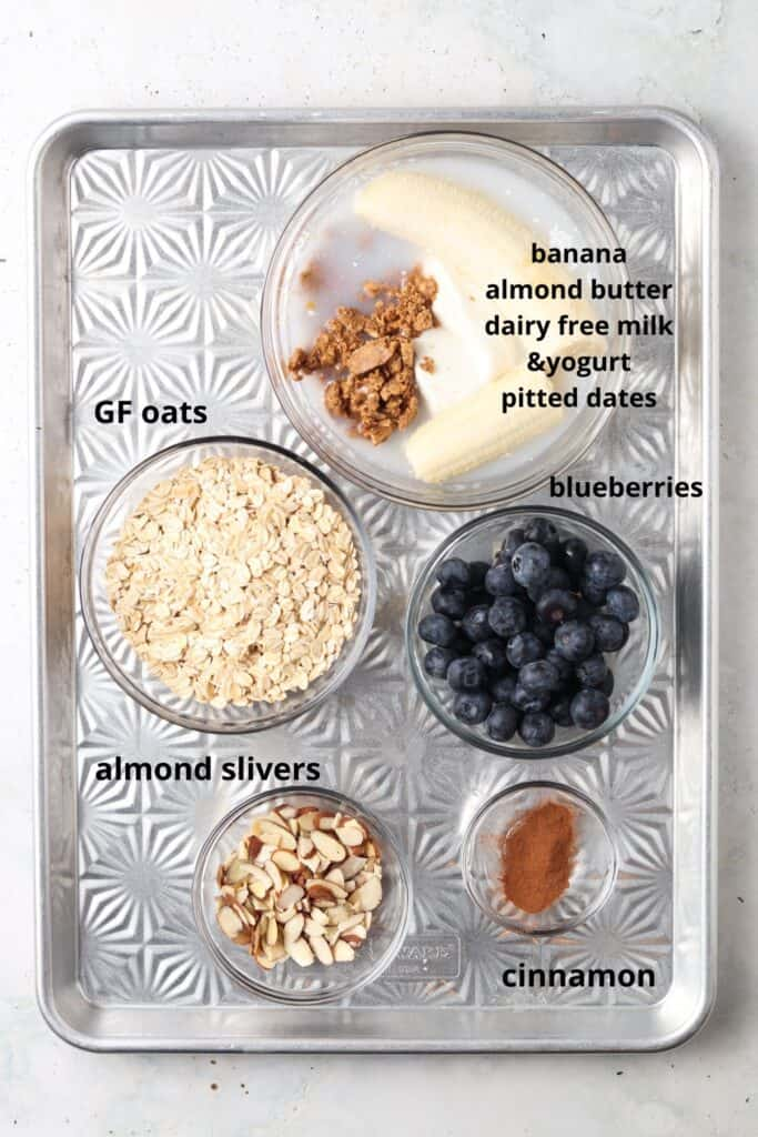 Blueberry Banana Overnight Oats recipe ingredients laid out on a metal pan