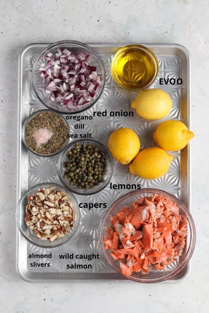 shredded lemon dill salmon salad ingredients on metal tray