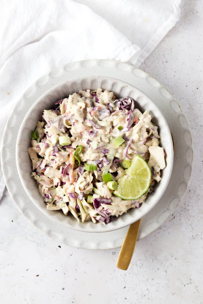 whole30 coleslaw in a bowl with a spoon