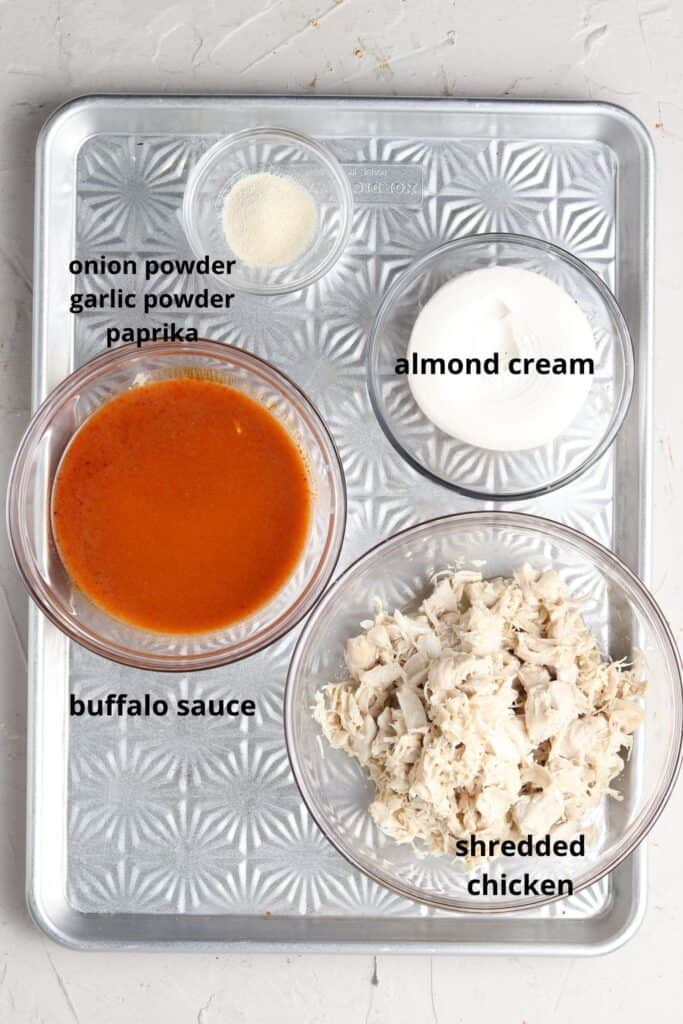 dairy free buffalo chicken dip ingredients on a tray