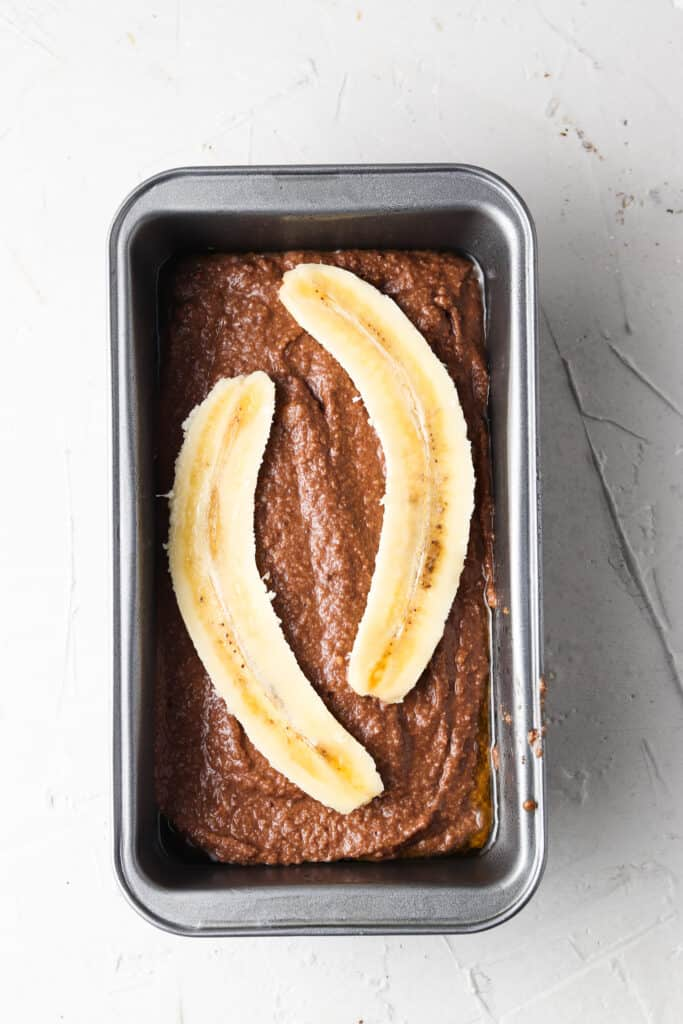 whole chocolate banana bread in a bread pan