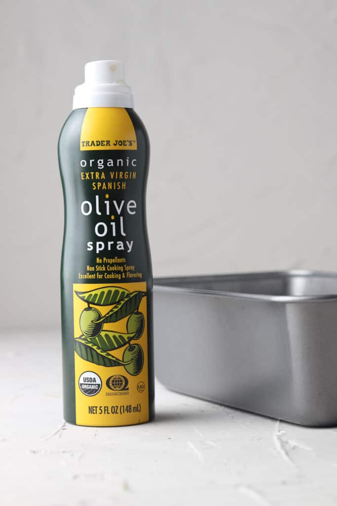 olive oil spray on a gray board for banana bread