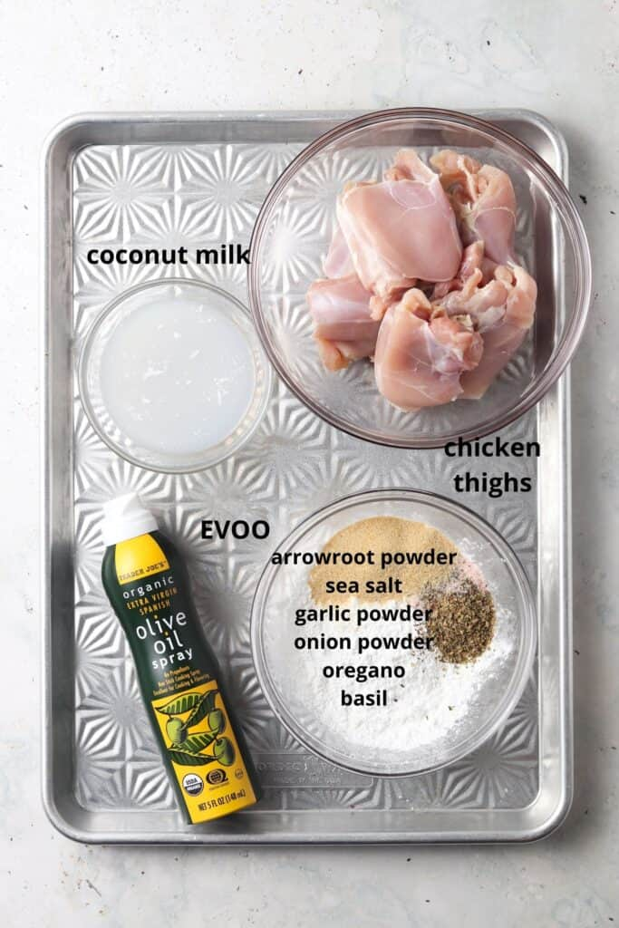 overview shot of the ingredients needed for crispy garlic aip chicken thighs on a metal tray