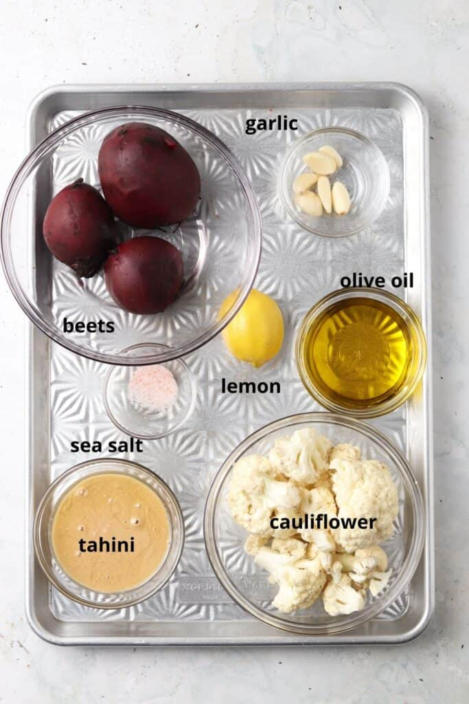 paleo beet hummus ingredients on a silver tray