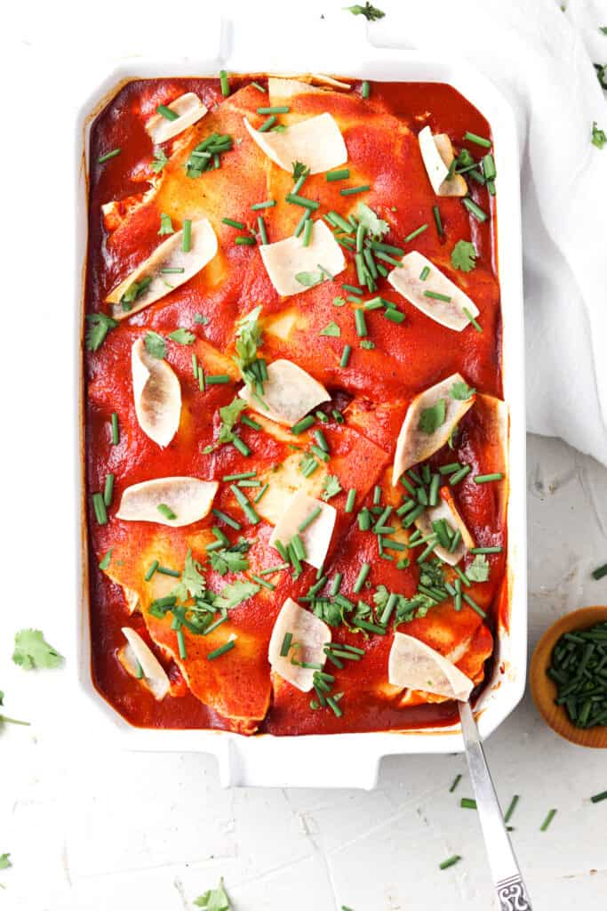 paleo mexican lasagna in a white dish with a white towel