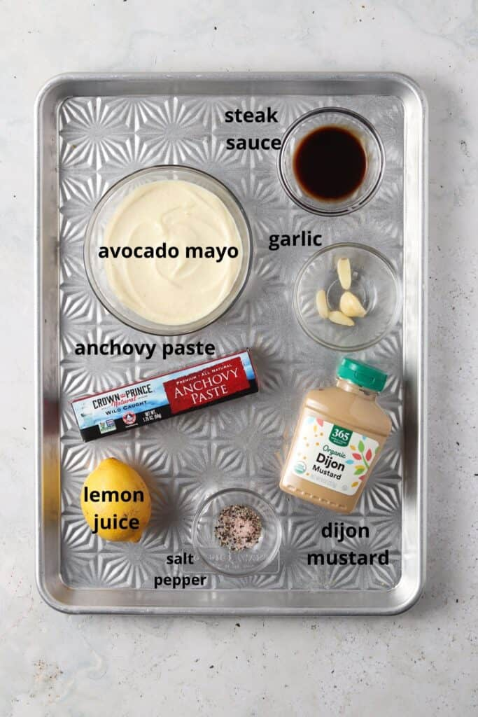 whole30 caesar dressing ingredients on a silver metal tray