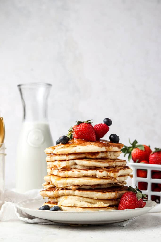aip pancakes on a plate with fresh berries and syrup