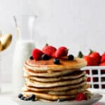 aip pancake stack on a grey plate with fruit
