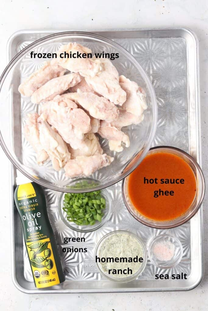 crispy buffalo chicken wings ingredients on a metal tray