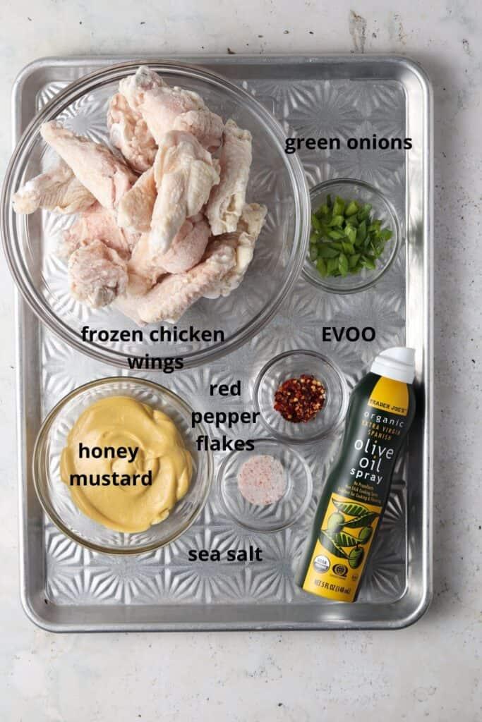honey mustard chicken wings ingredients on a metal tray