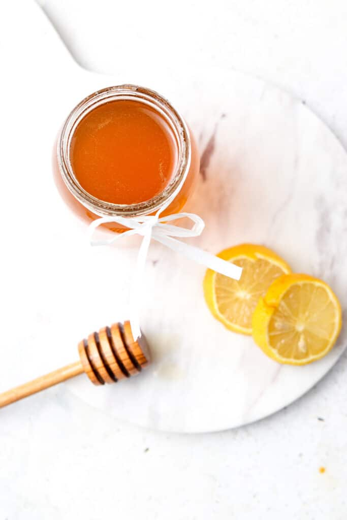 overhead shot of honey simple syrup and lemons