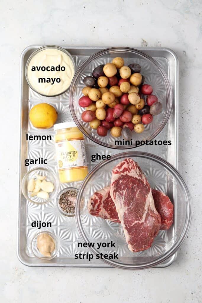 steak date night dinner ingredients on a metal tray