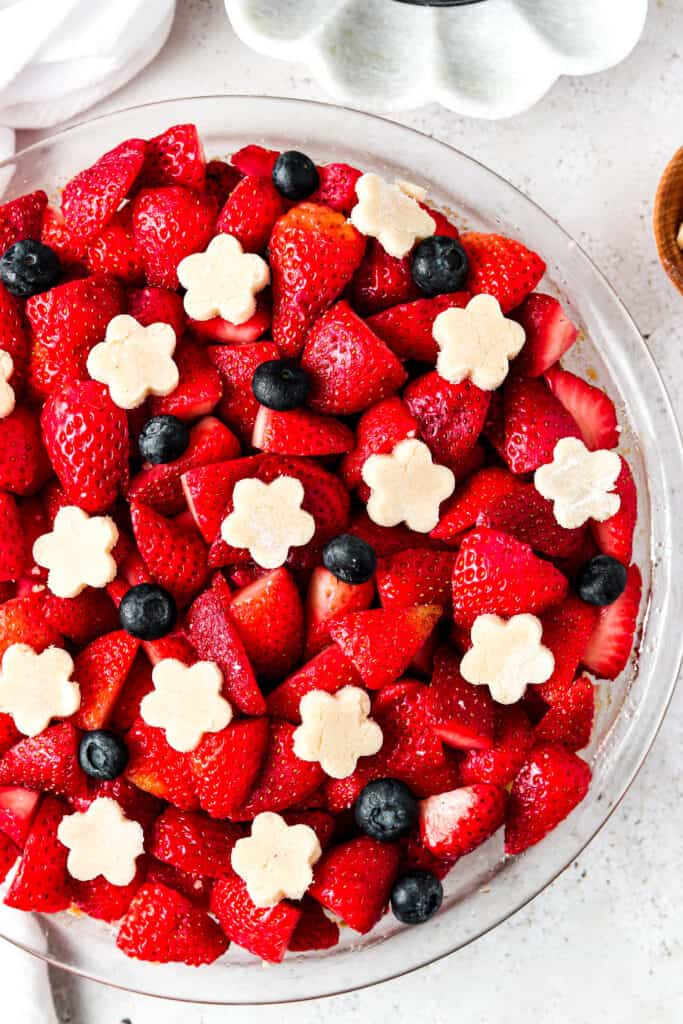 aip pie crust and berries close up in a pie dish