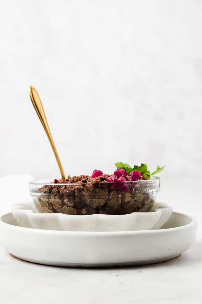 beef liver pate in a bowl with a spoon hanging out of it
