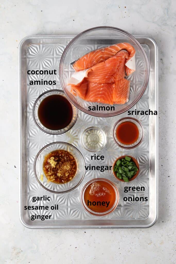 sriracha salmon ingredients on a metal tray
