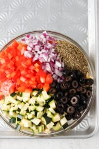 paleo pasta salad ingredients in a big bowl on a metal tray