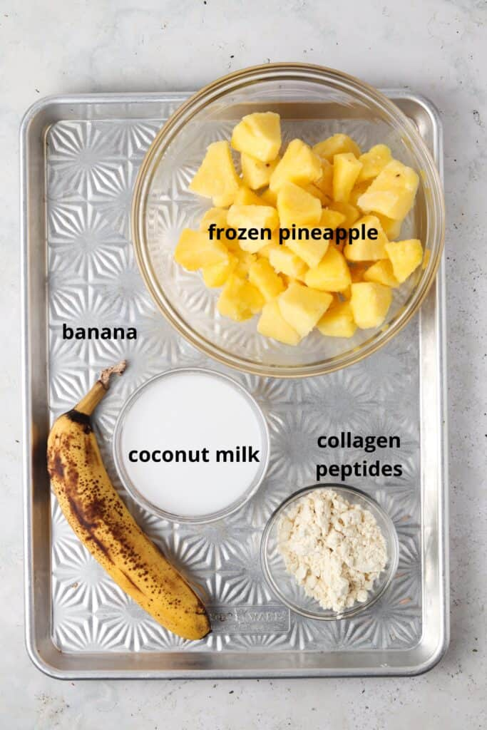 paleo pina colada ingredients on a metal tray in small bowls