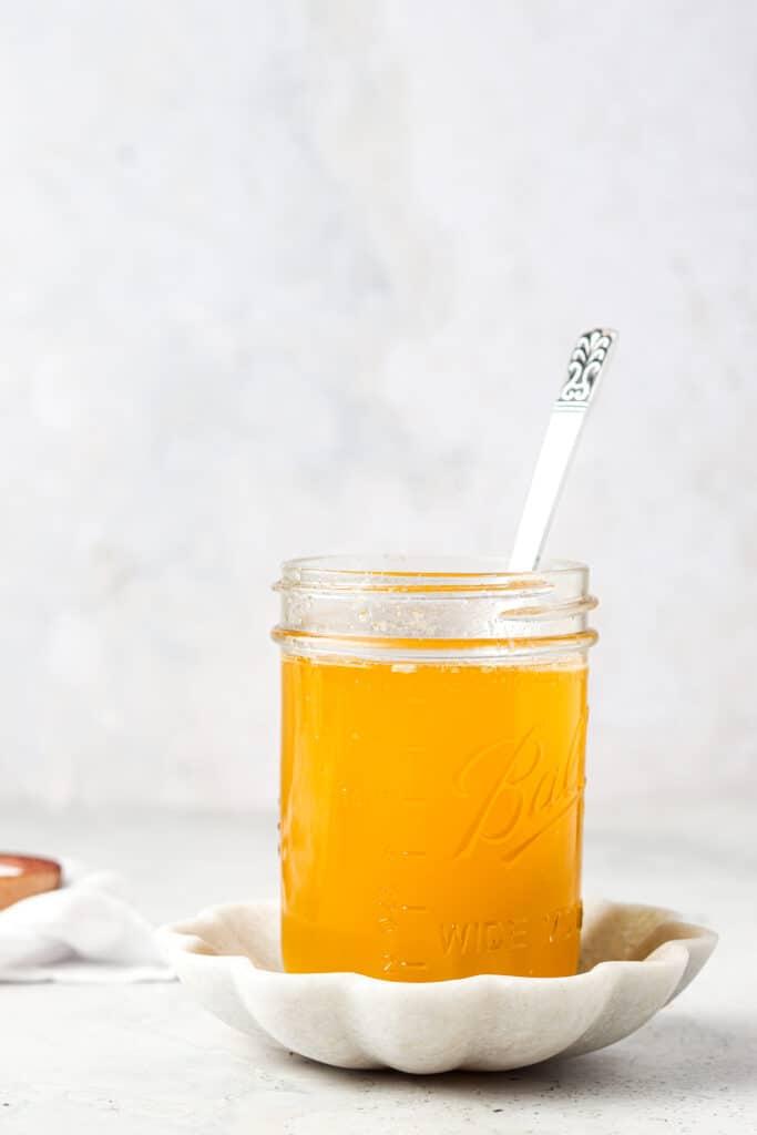 clarified butter in a mason jar in a spoon