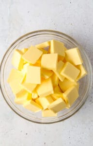 chopped up pieces of butter in a bowl