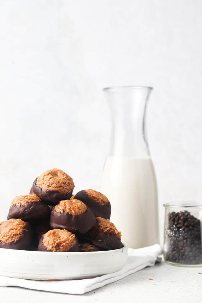 vegan buckeyes with a glass of dairy free milk and chocolate