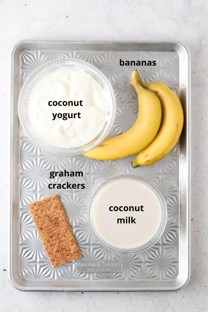 ingredients for banana cream smoothie on a tray
