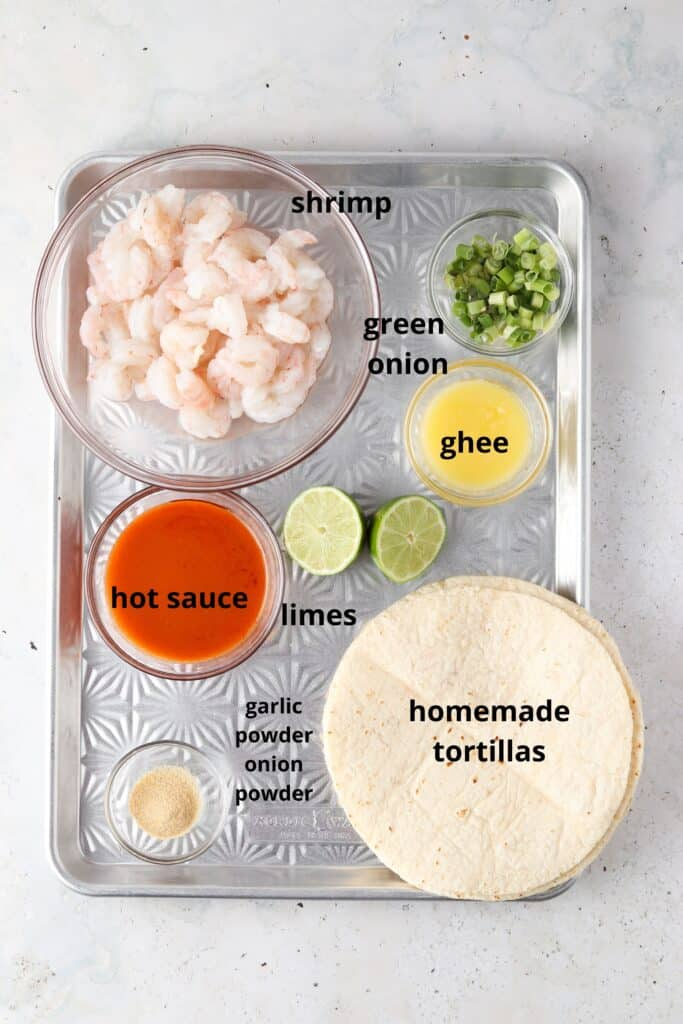 taco ingredients on a metal tray