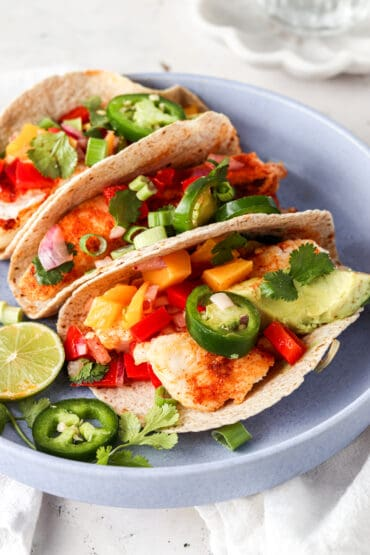 halibut fish tacos lined up in a blue bowl