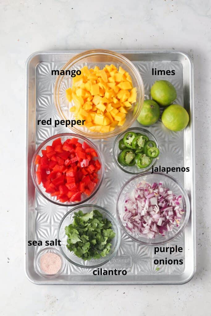 mango pico de gallo ingredients on a metal tray