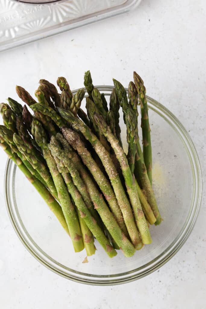 process shot of how to make asparagus in a bowl