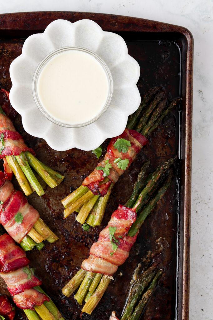 asparagus and aioli on a tray