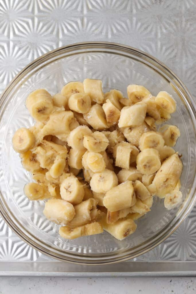chopped up frozen bananas in a bowl