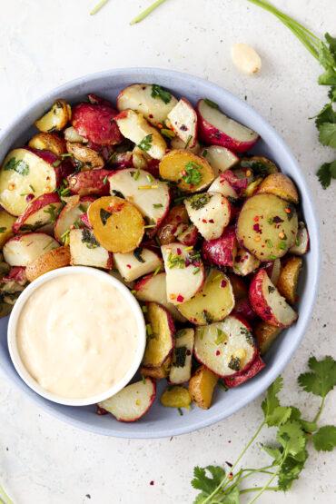 crispy potatoes on a blue plate