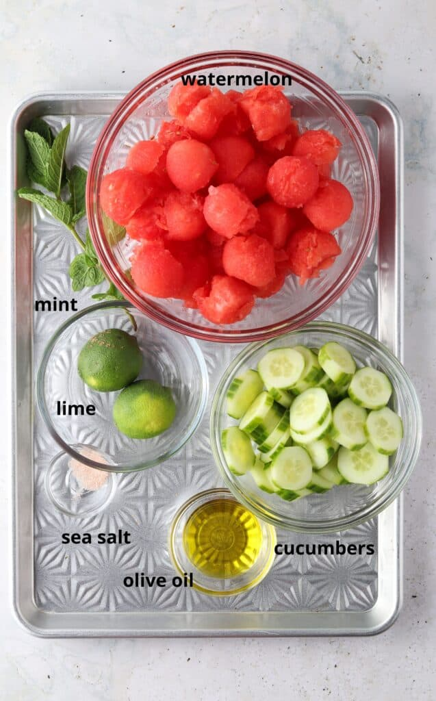 cucumber watermelon salad ingredients on a tray