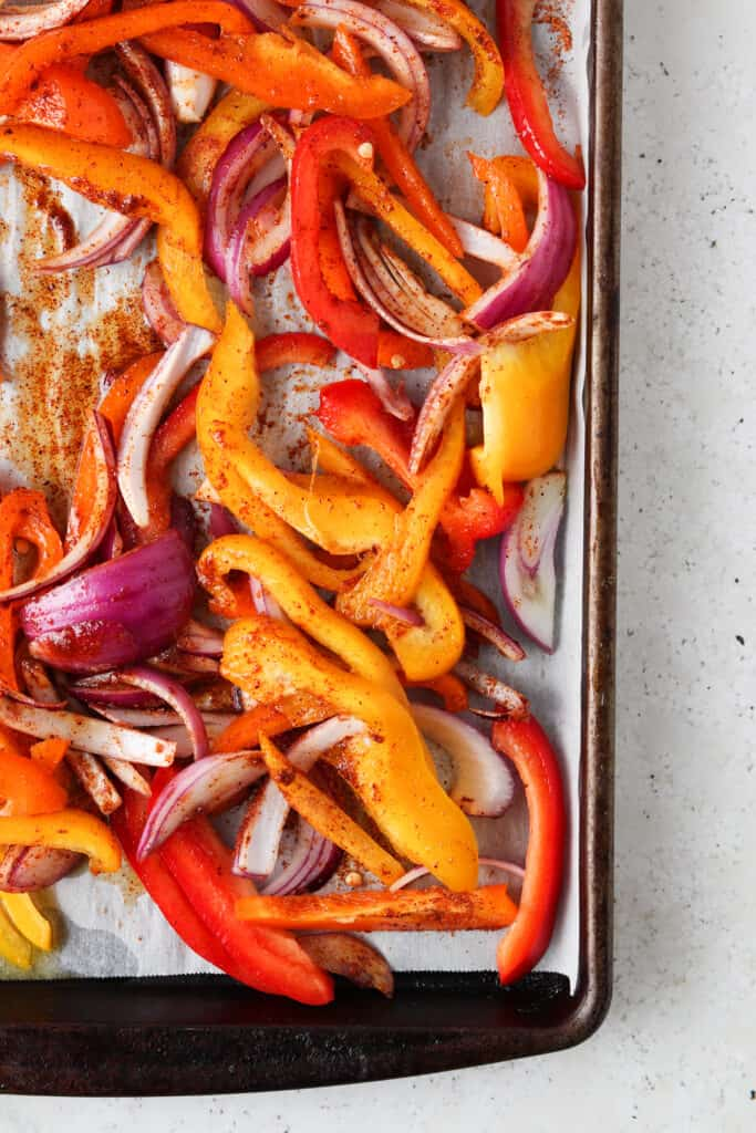 pepper and onions on a sheet pan