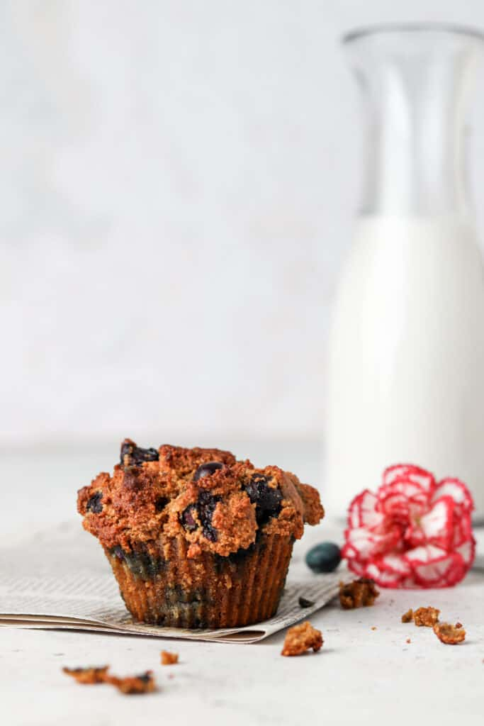 paleo blueberry muffin on a newspapper