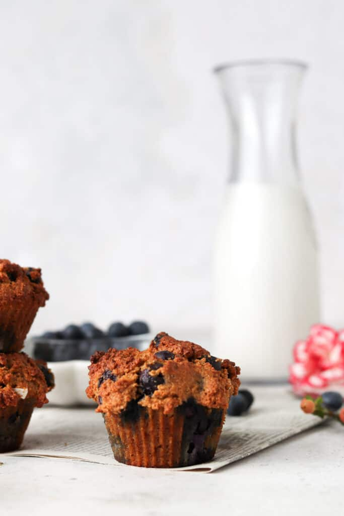muffin with almond milk and red flower