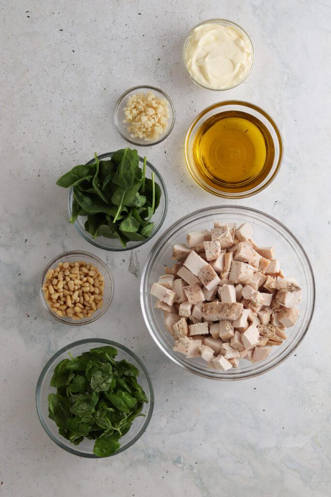 chicken salad ingredients in bowls