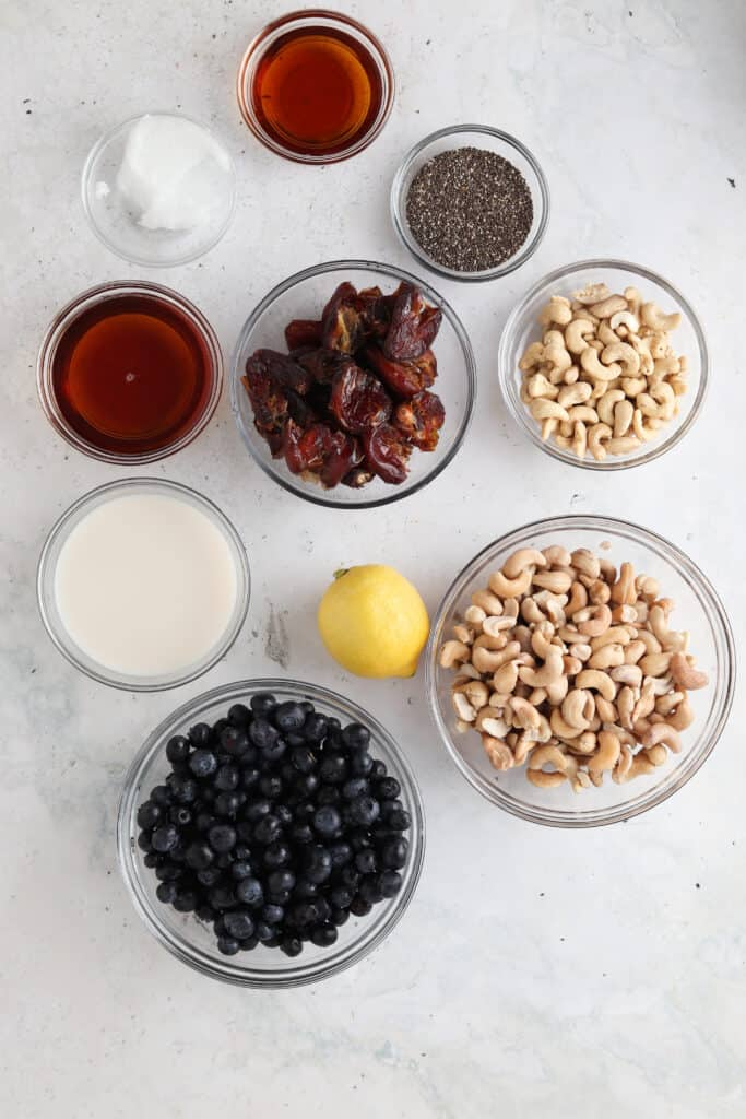 vegan blueberry cheesecake ingredients in small bowls