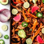 Sheet Pan Chicken Fajitas with lime wedges and jalapeño no slices