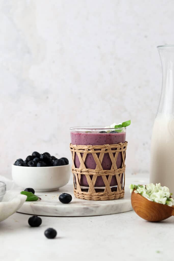 stawberry blueberry smoothie in a cup with blueberries