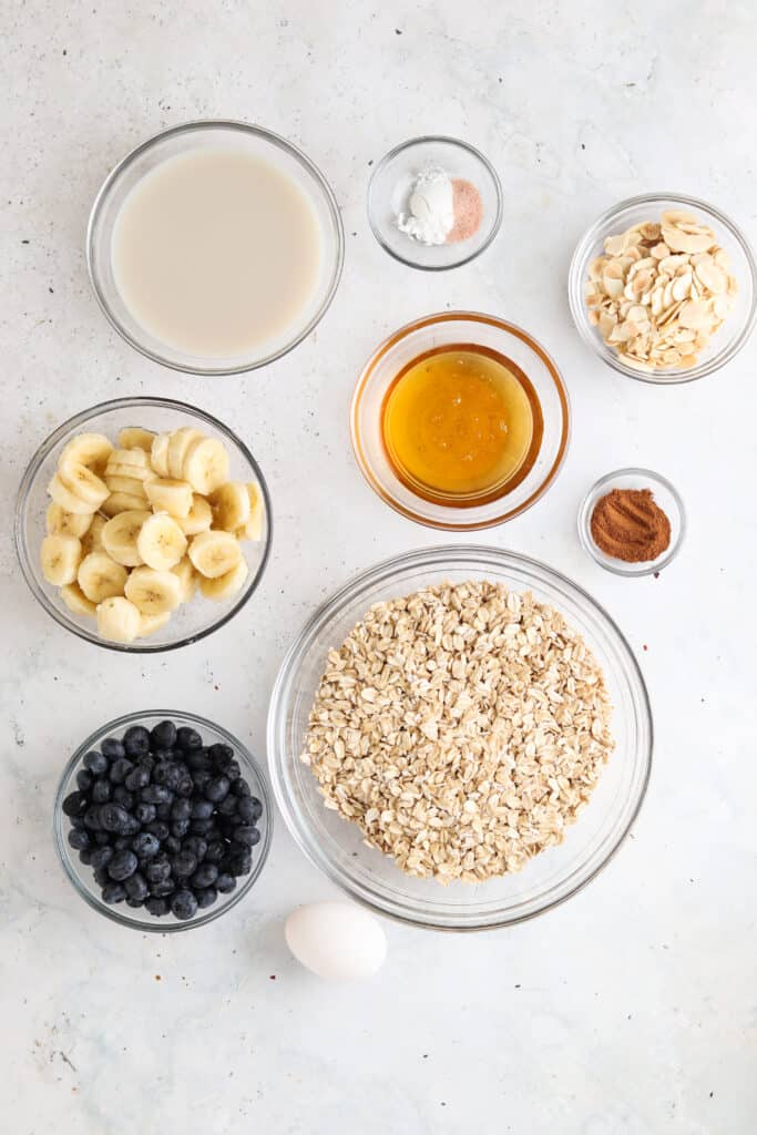 blueberry banana oatmeal bake ingredients in small bowls