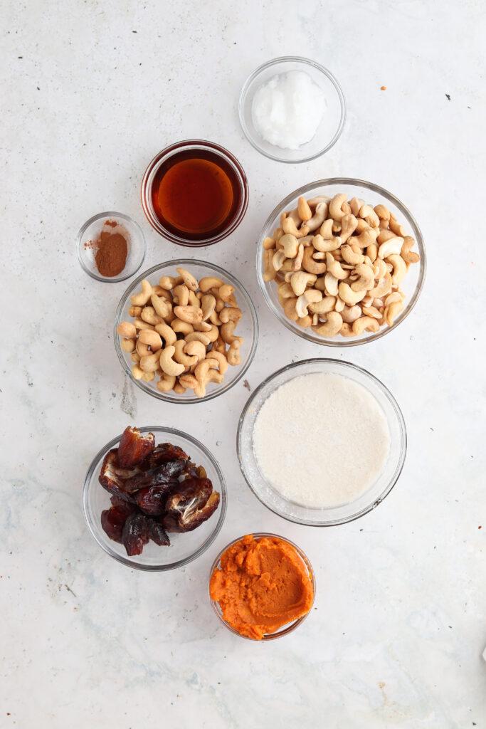 paleo pumpkin cheesecake ingredients in small bowls