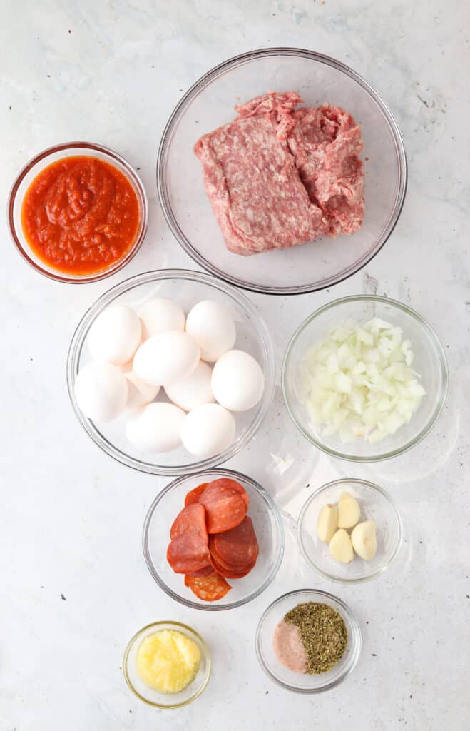 pizza egg muffins ingredients on a platter