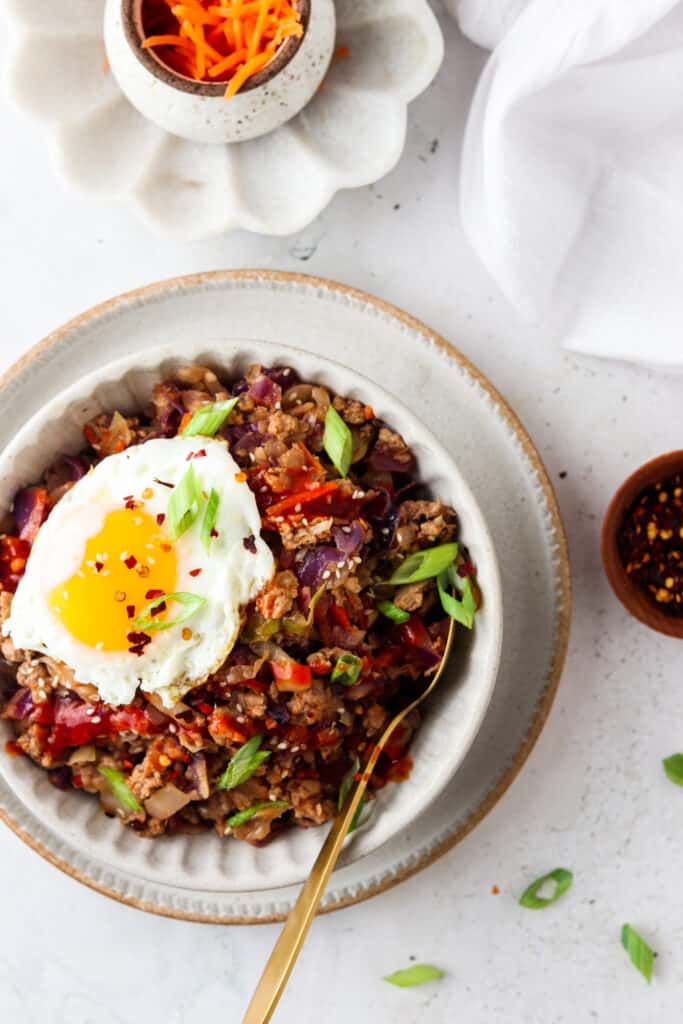 paleo egg roll in a bowl with an egg on top