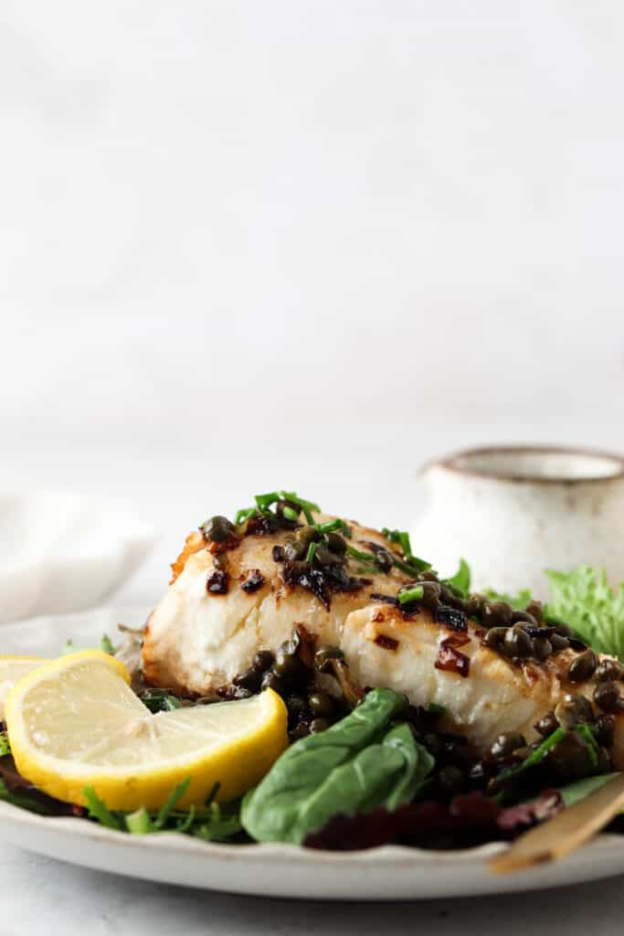 side shot of sea bass over greens