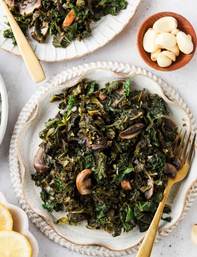 kale and mushrooms on a pretty plate